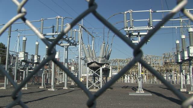 CU, ZI, SELECTIVE FOCUS, Electrical power station seen through chain link fence, Portland, Oregon, USA