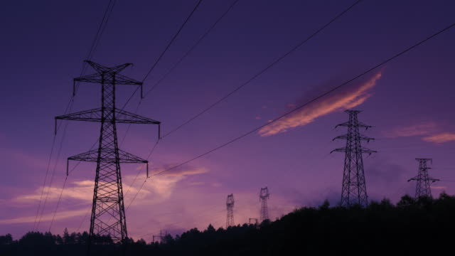 electrical pylons and morning glow 4k - electricity pylon stock videos & royalty-free footage