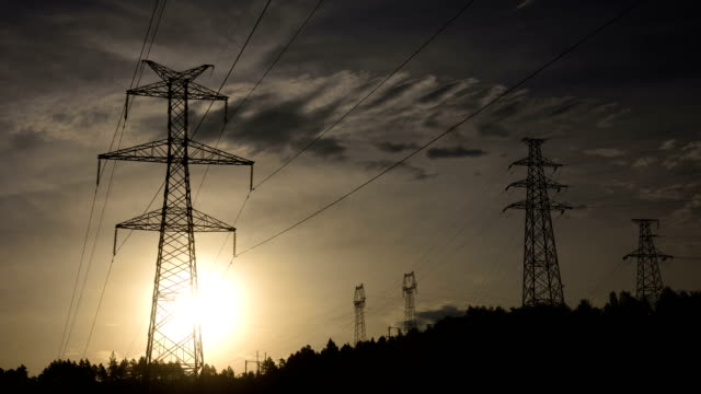 Electrical Pylons at sunrise 4K Time Lapse