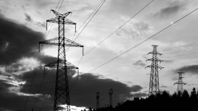 Electrical Pylons at sunrise 4K Time Lapse Video