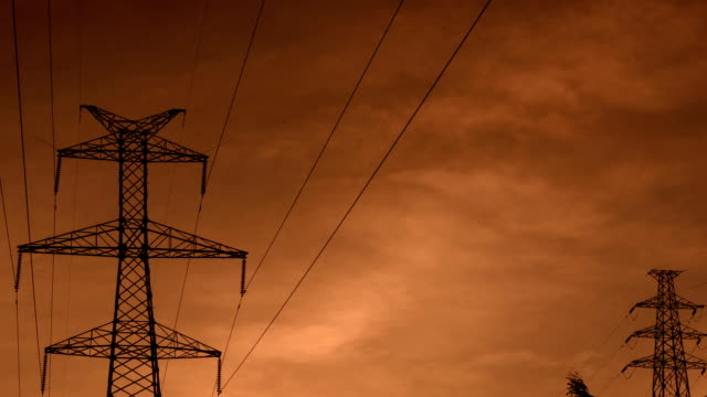 electrical pylons translation at sunrise hd - power line stock videos & royalty-free footage