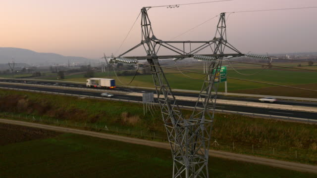 aerial electrical wiring above the highway - slovenia stock videos & royalty-free footage