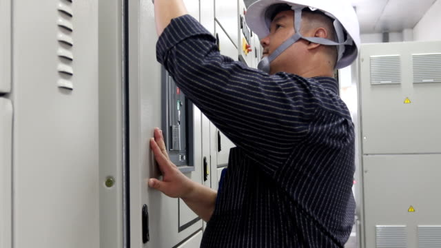 electrician at work on distribution board - electrician stock videos and b-roll footage
