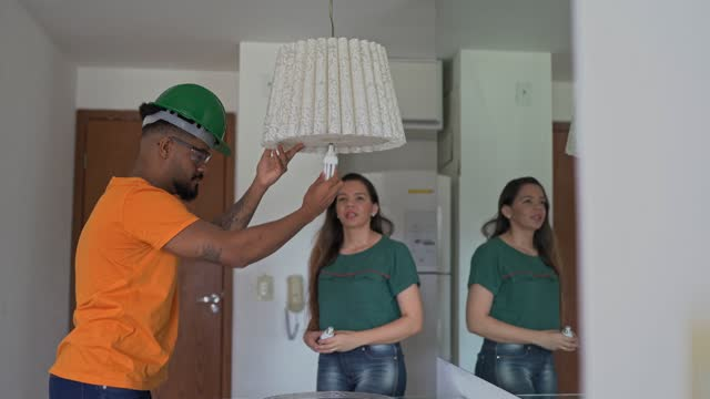 electrician changing lamp - changing lightbulb stock videos & royalty-free footage