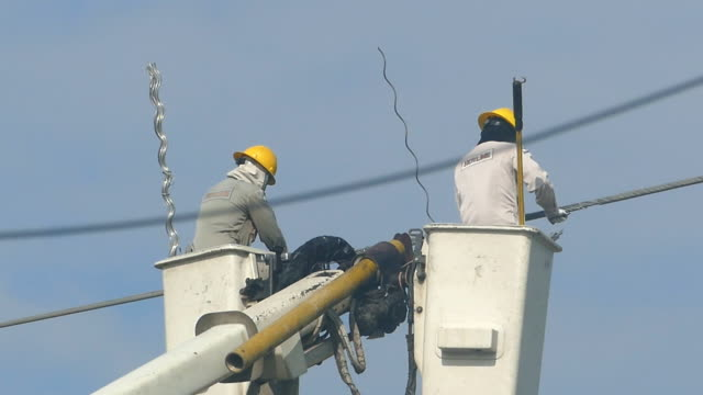 electrician climbing a newly installed utility pole - power supply stock videos & royalty-free footage