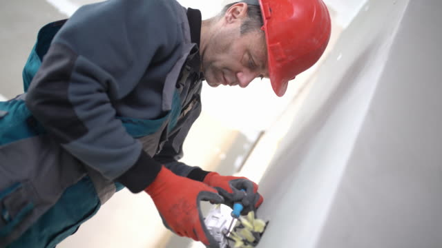 Electrician installing light switch.