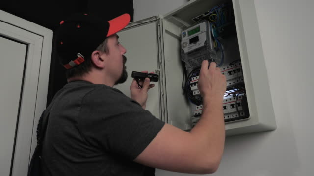 electrician repair fuse box, use flashlight, slow motion - electrician stock videos & royalty-free footage