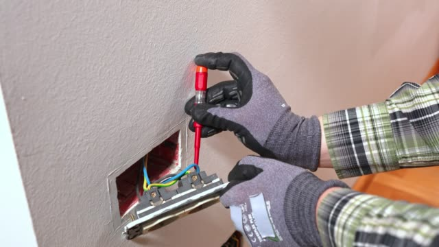 electrician using a screwdriver, working on electrical wiring - plug socket stock videos and b-roll footage