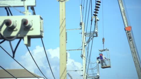 electrician wiring newly on pole - high up stock videos & royalty-free footage