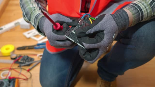 electrician working on installing new electrical plugs - plug socket stock videos & royalty-free footage