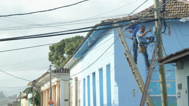 electricians or telecommunication technicians working on street cables in trinidad, cuba - ladder stock videos & royalty-free footage