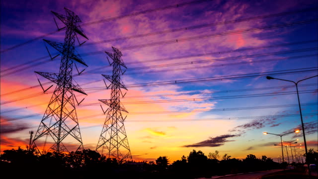 electricity high voltage power pylon at dusk - electricity pylon stock videos & royalty-free footage