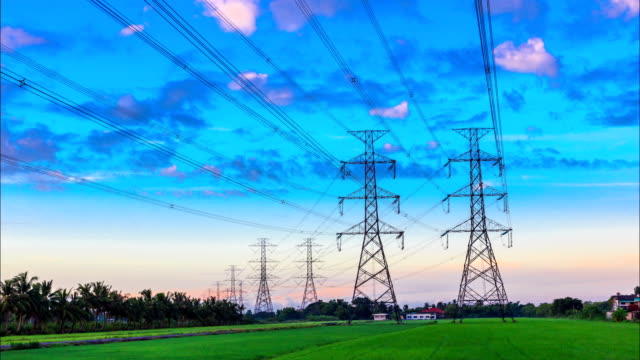 electricity high voltage power pylon at morning - sending stock videos and b-roll footage