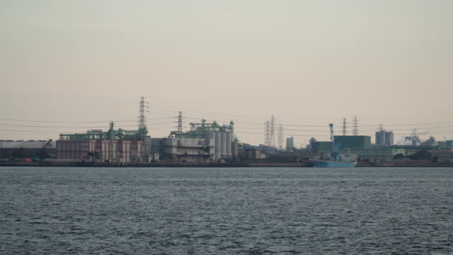electricity plant and chemical factory on the bay at sunset at Nagoya, Japan