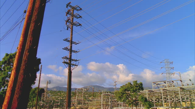 T/L MS LA Electricity pole against sky, Santa Barbara electrical substation in background, Santa Barbara, California, USA