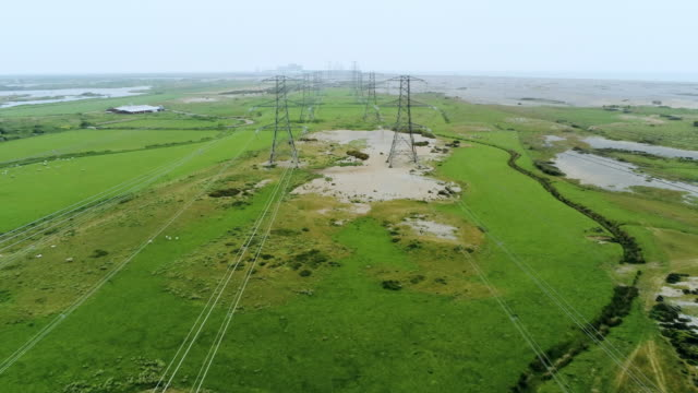 electricity power lines and pylons - electricity pylon stock videos & royalty-free footage