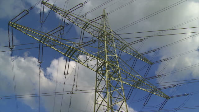 electricity pylon against sky time lapse - electricity pylon stock videos and b-roll footage