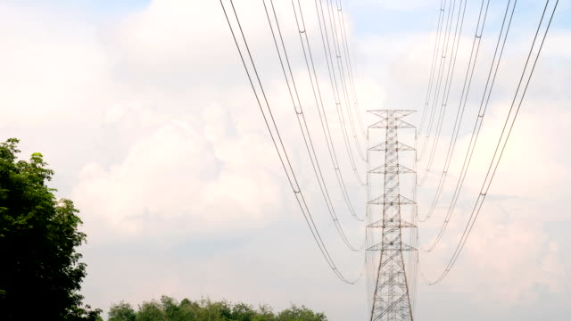 Electricity pylon and time-lapse cloudy sky animation.