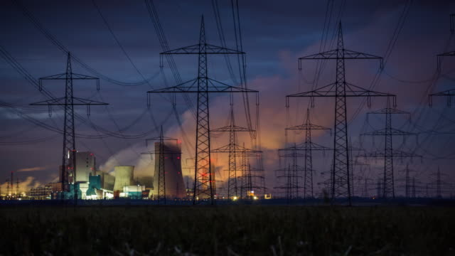 electricity pylons and power station - time lapse - high voltage stock videos & royalty-free footage
