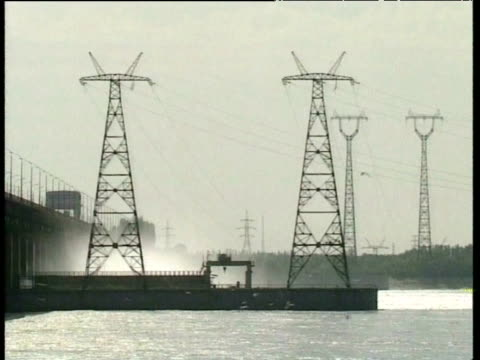 electricity pylons connected to volgograd dam russia - power station stock videos & royalty-free footage
