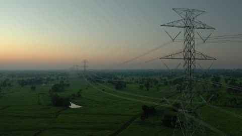 electricity pylons dolly shot - high voltage sign stock videos & royalty-free footage