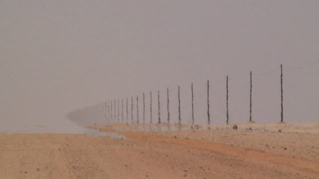 ws electricity pylons in desert / namib desert, namibia - heat haze stock videos & royalty-free footage