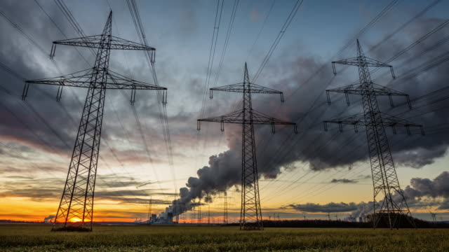 TIME LAPSE: Electricity Pylons in front of a lignite power plant
