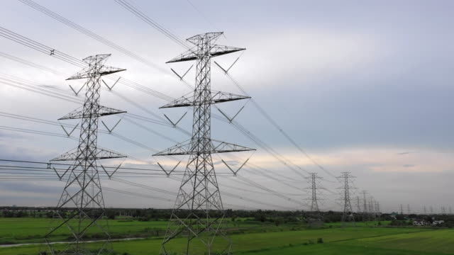 aerial electricity pylons in the countryside stock video - power cable stock videos & royalty-free footage