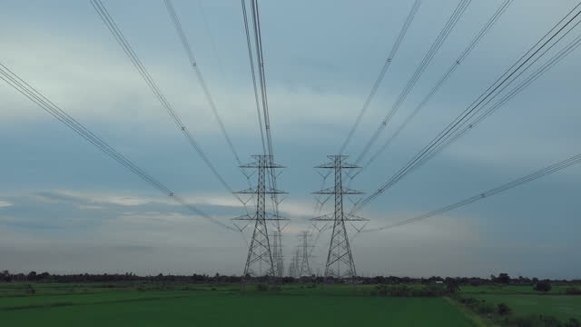 aerial electricity pylons in the countryside stock video - electricity pylon stock videos & royalty-free footage
