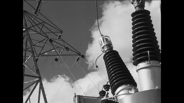montage electricity running through wires throughout the countryside / england, united kingdom - 1935 stock videos & royalty-free footage