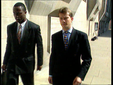 Man acquitted of assault and weapons offences ENGLAND Cambridgeshire EXT TCMS Hand locking car TILT UP and PAN RL as Roderic Minshull walks away...
