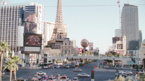 electronic billboards flash near a replica of the eiffel tower in las vegas, nevada. - las vegas replica eiffel tower stock videos & royalty-free footage
