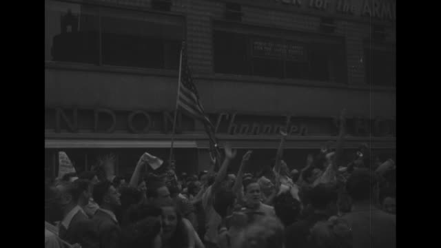 ls electronic bulletin board on new york building reads truman announces people celebrate in the streets / mws people celebrating in nyc streets... - surrendering stock videos & royalty-free footage