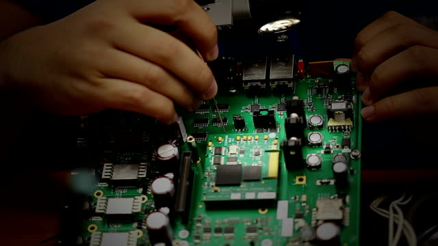 electronic engineer checking circuit board - quality control stock videos & royalty-free footage