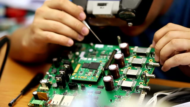 Electronic engineer repairs circuit board