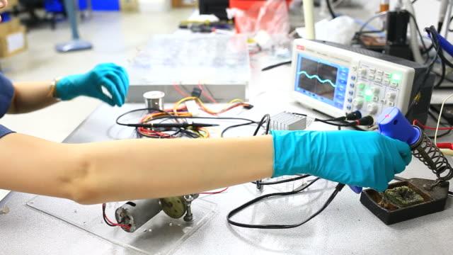 Electronic Engineer testing circuit board.