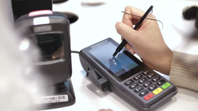 electronic signature on credit card reader for credit card purchase - signing stock videos & royalty-free footage