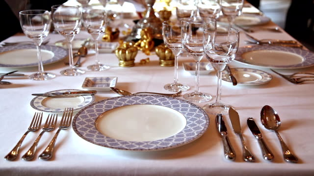 elegant candlelight dinner table at a reception in manor house - dining table stock videos & royalty-free footage