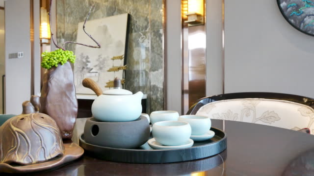 elegant ceramic crockery on table in luxury living room