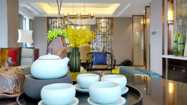 elegant ceramic crockery on table in luxury living room