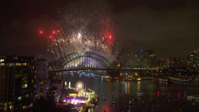 elegant colourful fireworks behind the harbour bridge - sydney stock videos & royalty-free footage