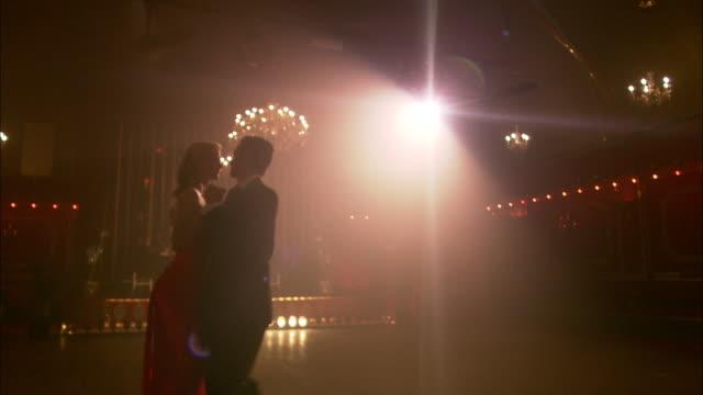 ms, la, elegant couple dancing in ballroom, string quartet in background, london, england - 2009 stock videos & royalty-free footage