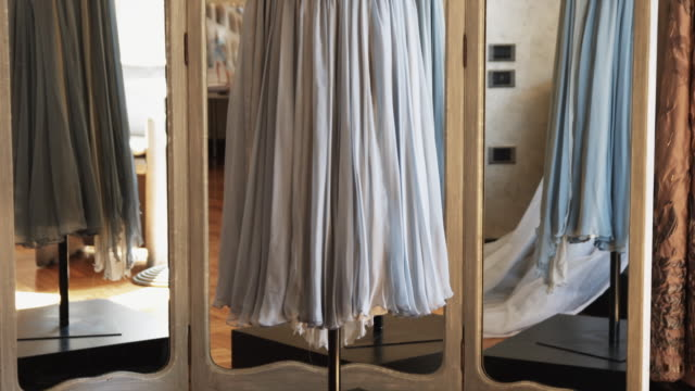 MS TU Elegant dress on stand in front of mirror / Milan, Italy