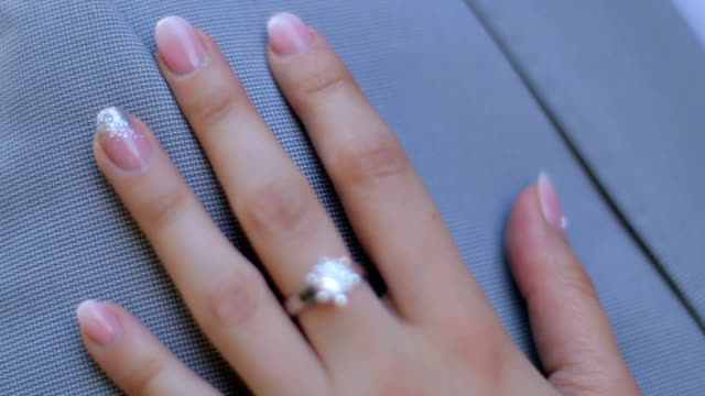 elegant engagement diamond ring on woman finger - fiancé stock videos & royalty-free footage