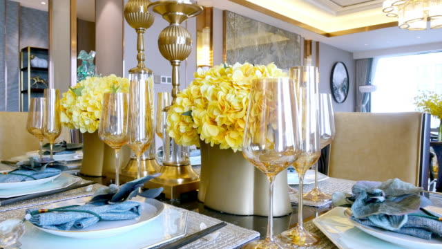elegant glass and crockery on table in modern dining room - dining room stock videos & royalty-free footage