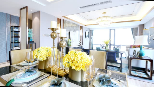 elegant glasses and crockery on table in modern dining room