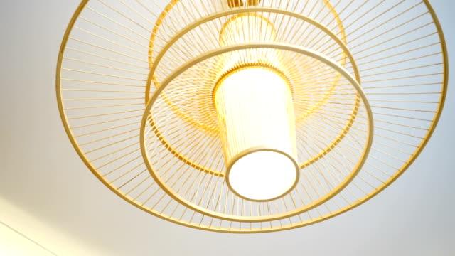 elegant japanese style droplight on ceiling in room - pendant light stock videos & royalty-free footage