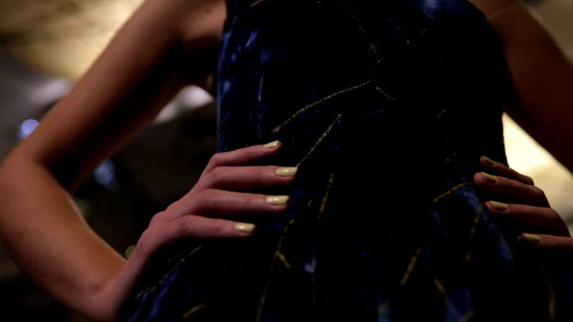 elegant lady in blue dress holding hands on hips - lobby video stock e b–roll