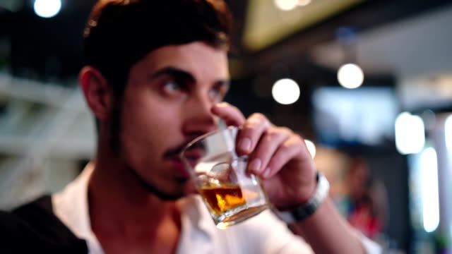 elegant man drinking whiskey in the bar - whiskey stock videos and b-roll footage