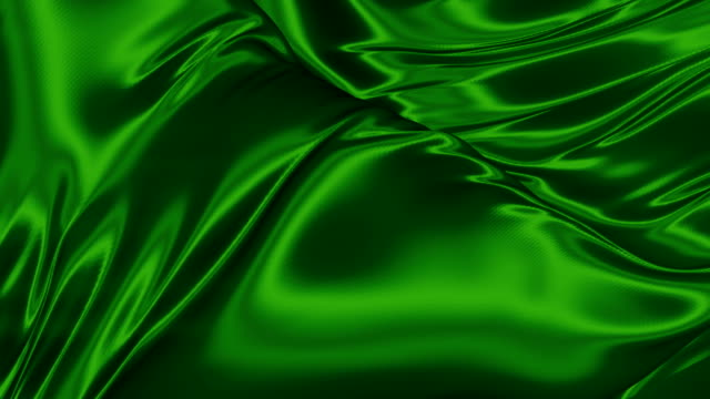 elegant shiny green metallic cloth background. modern animation for decoration design. 3d rendering. 4k, ultra hd resolution - raso video stock e b–roll